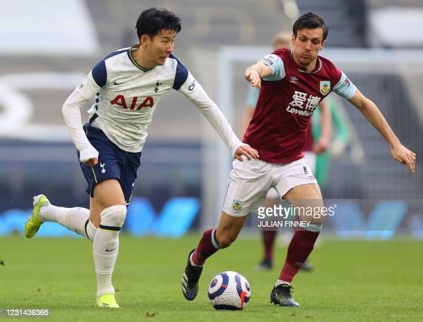 Tottenham Hotspur's South Korean striker Son Heung-Min vies with Burnley's English midfielder Jack Corkduring the English Premier League football...