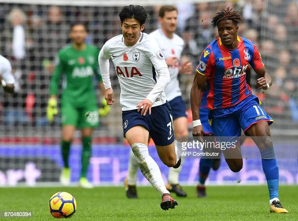 Tottenham Hotspur's South Korean striker Son HeungMin vies with Crystal Palace's Ivorian striker Wilfried Zaha during the English Premier League...