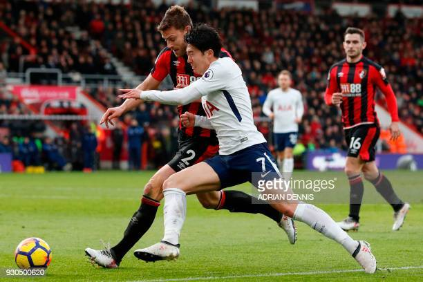 Tottenham Hotspur's South Korean striker Son HeungMin vies with Bournemouth's English defender Simon Francis during the English Premier League...