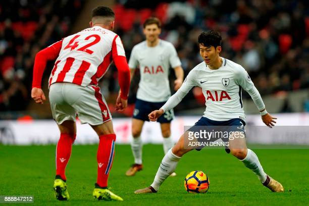 Tottenham Hotspur's South Korean striker Son HeungMin vies with Stoke City's English defender Tom Edwards during the English Premier League football...
