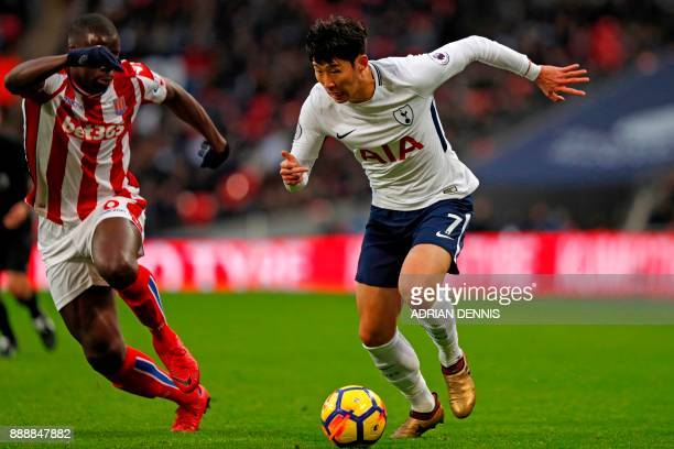 Tottenham Hotspur's South Korean striker Son HeungMin vies with Stoke City's French defender Kurt Zouma during the English Premier League football...