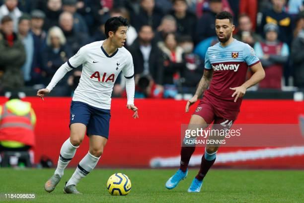 Tottenham Hotspur's South Korean striker Son HeungMin vies with West Ham United's English defender Ryan Fredericks during the English Premier League...