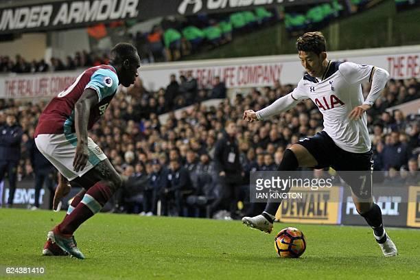 Tottenham Hotspur's South Korean striker Son HeungMin vies with West Ham United's English midfielder Michail Antonio during the English Premier...