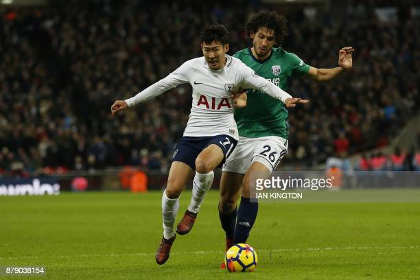 Tottenham Hotspur's South Korean striker Son HeungMin vies with West Bromwich Albion's Egyptian defender Ahmed Hegazy during the English Premier...