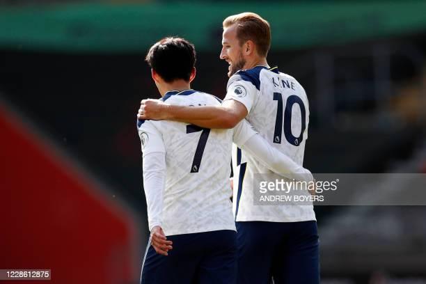 Tottenham Hotspur's South Korean striker Son Heung-Min walks back to the half-way line after Tottenham Hotspur's English striker Harry Kane scores...
