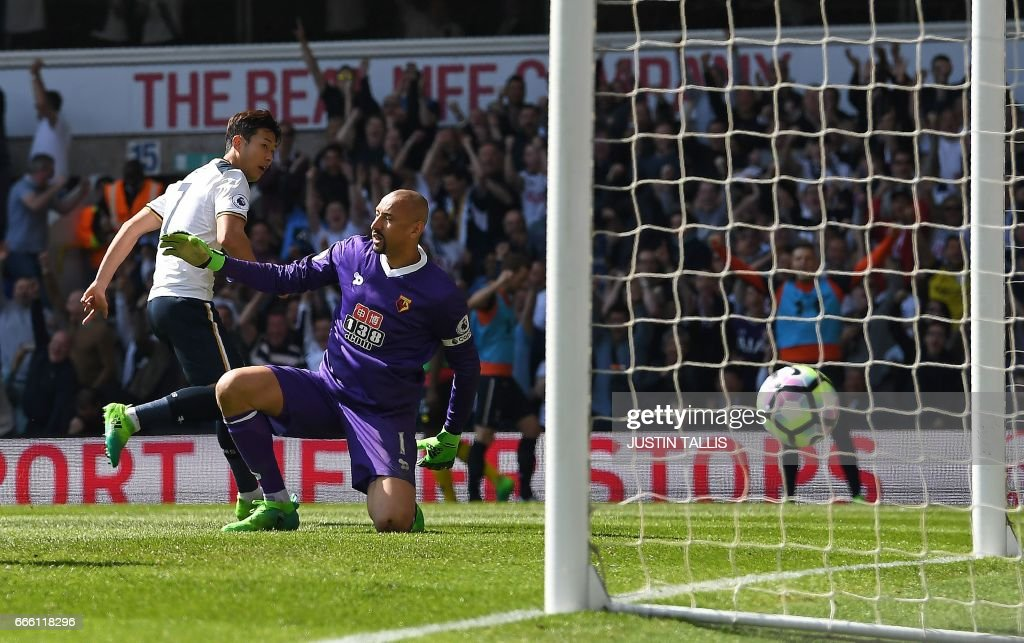 Tottenham Hotspur's South Korean striker Son Heung-Min (L) watches the ball pass Watford's Brazilian goalkeeper Heurelho Gomes and score his team's fourth goal, and his second goal during the English Premier League football match between Tottenham Hotspur and Watford at White Hart Lane in London, on April 8, 2017. / AFP PHOTO / Justin TALLIS / RESTRICTED TO EDITORIAL USE. No use with unauthorized audio, video, data, fixture lists, club/league logos or 'live' services. Online in-match use limited to 75 images, no video emulation. No use in betting, games or single club/league/player publications. /