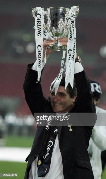Tottenham Hotspur's Spanish manager Juande Ramos celebrates with the trophy after his team won the Carling Cup Final against Chelsea at Wembley...