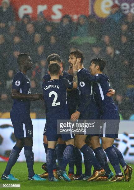 Tottenham Hotspur's Spanish striker Fernando Llorente celebrates with teammates after scoring the opening goal of the English Premier League football...