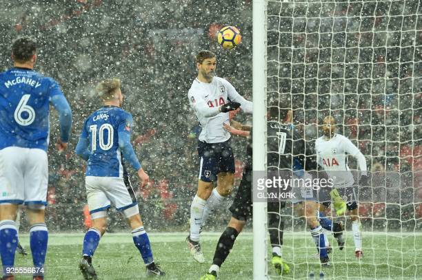 TOPSHOT Tottenham Hotspur's Spanish striker Fernando Llorente scores the team's fourth goal during the English FA Cup 5th round replay football match...