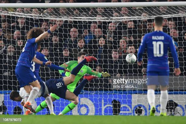 Tottenham Hotspur's Spanish striker Fernando Llorente scores their first goal past Chelsea's Spanish goalkeeper Kepa Arrizabalaga during the English...