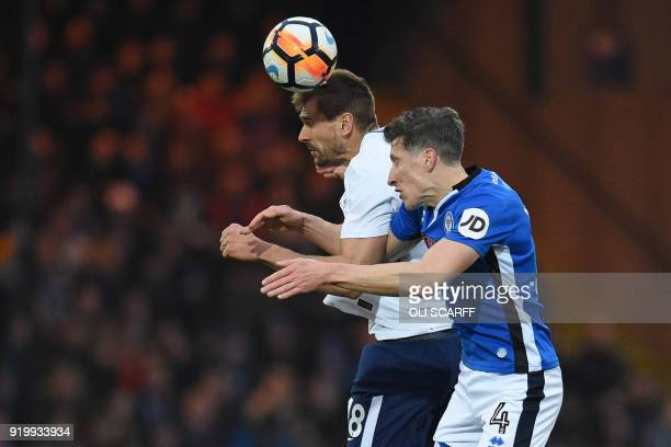 Tottenham Hotspur's Spanish striker Fernando Llorente vies with Rochdale's English defender Jimmy McNulty during the English FA Cup fifth round...