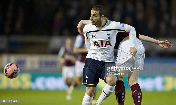 Tottenham Hotspur's Spanish striker Roberto Soldado holds the shorts of Burnley's English defender Ben Mee during the English FA Cup third round...
