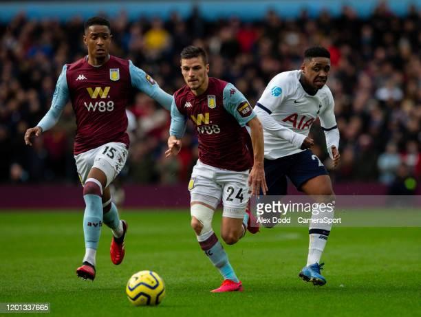 Tottenham Hotspur's Steven Bergwijn battles with Aston Villa's Frederic Guilbert during the Premier League match between Aston Villa and Tottenham...