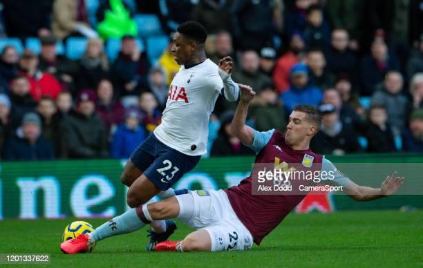 Tottenham Hotspur's Steven Bergwijn is tackled by Aston Villa's Bjorn Engels during the Premier League match between Aston Villa and Tottenham...