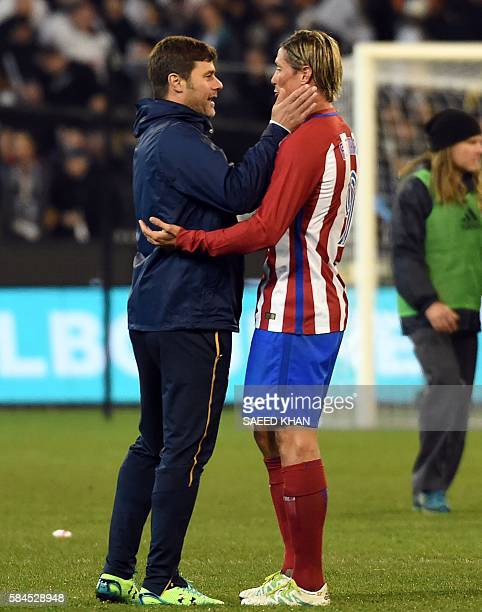Tottenham Hotspurs team manager Mauricio Pochettino greets Atletico Madrid's attacker Fernando Torres during the International Champions Cup football...