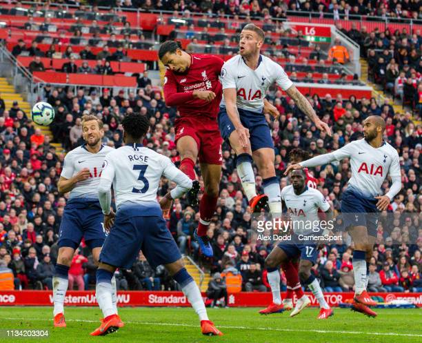 Tottenham Hotspur's Toby Alderweireld and Liverpool's Virgil van Dijk compete in the air during the Premier League match between Liverpool FC and...