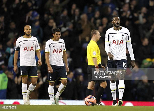 Tottenham Hotspur's Togolese striker Emmanuel Adebayor reacts after Leicester City's Argentinian striker Leonardo Ulloa scored their second and...