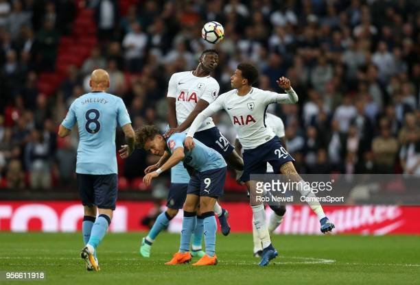 Tottenham Hotspur's Victor Wanyama and Dele Alli challenge Newcastle United's Dwight Gayle during the Premier League match between Tottenham Hotspur...