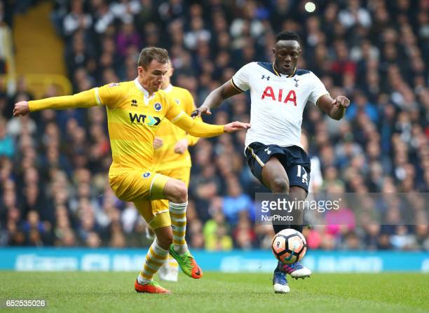 Tottenham Hotspur's Victor Wanyama beats Millwall's Jed Wallace during the The Emirates FA Cup Sixth Round match between Tottenham Hotspur and...