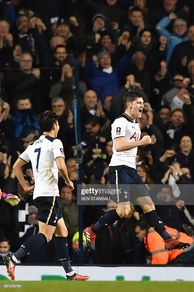 Tottenham Hotspur's Welsh defender Ben Davies (R) celebrates after scoring the opening goal of the English FA Cup third round football match between Tottenham Hotspur and Aston Villa at White Hart Lane in London, on January 8, 2017. / AFP / Ben STANSALL / RESTRICTED TO EDITORIAL USE. No use with unauthorized audio, video, data, fixture lists, club/league logos or 'live' services. Online in-match use limited to 75 images, no video emulation. No use in betting, games or single club/league/player publications. /