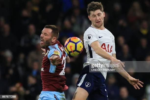 Tottenham Hotspur's Welsh defender Ben Davies vies with Burnley's Englishborn Scottish defender Phil Bardsley during the English Premier League...