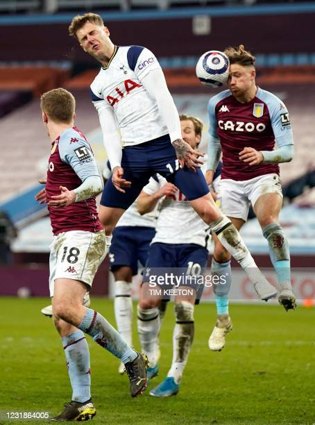 Tottenham Hotspur's Welsh defender Joe Rodon and Aston Villa's English defender Matty Cash jump for the ball during the English Premier League...