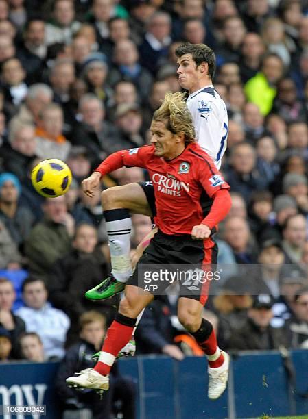 Tottenham Hotspur's Welsh player Gareth Bale vies with Blackburn Rovers' Spanish defender Michel Salgado during the English Premier League football...