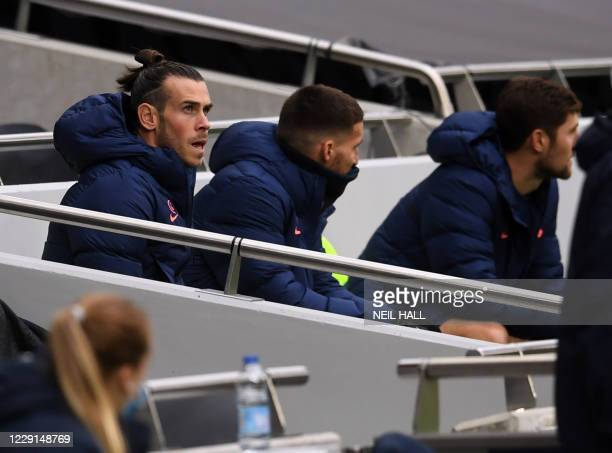 Tottenham Hotspur's Welsh striker Gareth Bale takes his seat on the bench for the English Premier League football match between Tottenham Hotspur and...