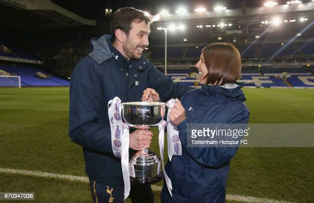 Tottenham Ladies First Team Head Coach Juan Amoros and Team Manager Karen Hills celebrate with the trophy for winning the FA Women's Premier League...