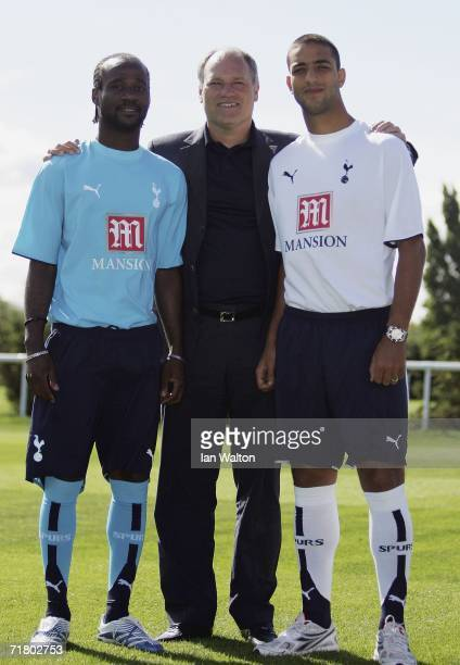 Tottenham mager Martin Jol poses for photographers with new signings Pascal Chimbonda and Mido during a Tottenham Hotspur Press Conferenceon on...