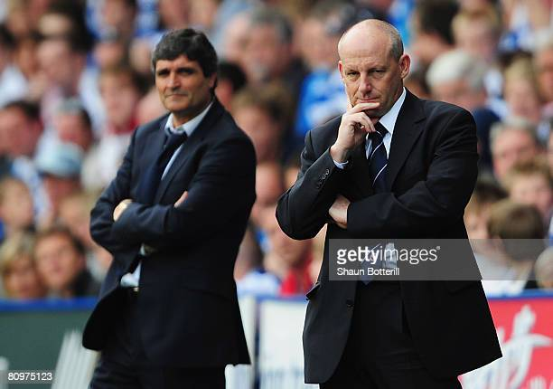 Tottenham Manager Juande Ramos and Reading Manager Steve Coppell look on from the sidelines during the Barclays Premier League match between Reading...