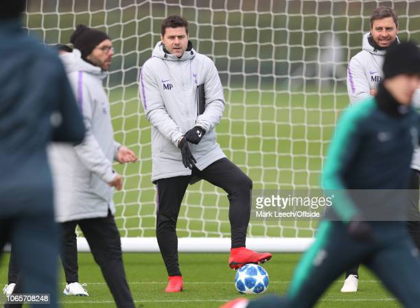 Tottenham manager Mauricio Pochettino puts his gloves on as he watches training during the Tottenham Hotspur Training Session at the Tottenham...
