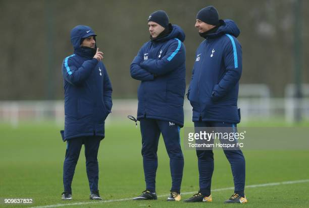 Tottenham manager mauricio Pochettino with assistant Jesus Perez and head coach Miguel D'Agostino during the Tottenham Hotspur training session at...