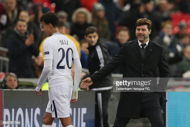 Tottenham manager Mauricio Pochettino with Dele Alli after he is substituted during the UEFA Champions League group H match between Tottenham Hotspur...