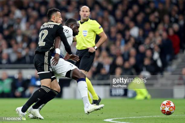 Tottenham midfielder Moussa Sissoko holds off a challenge from Ajax defender Noussair Mazraoui during the UEFA Champions League match between...