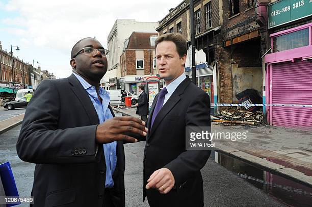 Tottenham MP David Lammy and Deputy Prime Minister Nick Clegg look at some of the damage caused to local businesses after rioting broke out in...