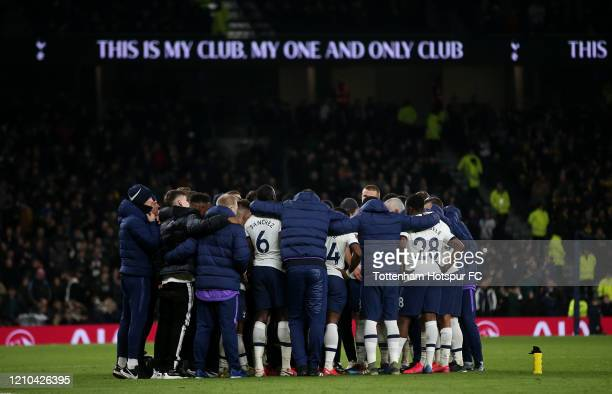 Tottenham players and coaching staff huddle before penalties during the FA Cup Fifth Round match between Tottenham Hotspur and Norwich City at...