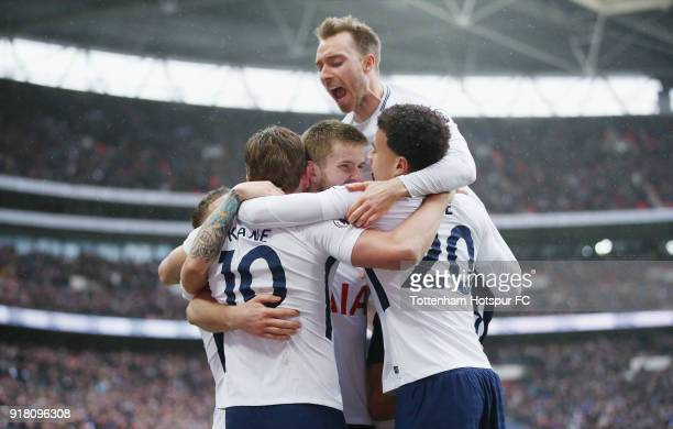 Tottenham players celebrate after Harry Kane of Tottenham scores their first goal during the Premier League match between Tottenham Hotspur and...