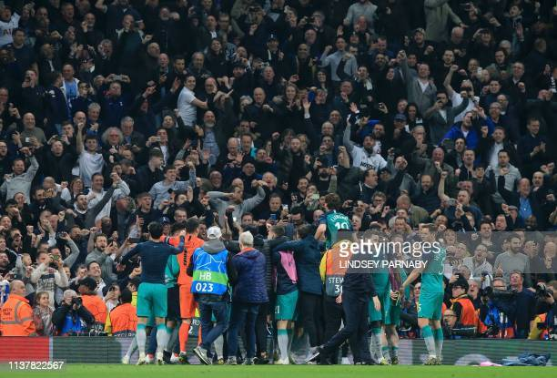 Tottenham players celebrate in fron to of their fans after the UEFA Champions League quarter final second leg football match between Manchester City...