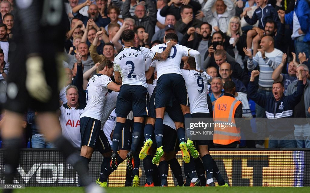 Tottenham players celebrate with Victor Wanyama after his winning goal during the English Premier League football match between Tottenham Hotspur and Crystal Palace at White Hart Lane in London, on August 20, 2016. Tottenham won the game 1-0. / AFP / Glyn KIRK / RESTRICTED TO EDITORIAL USE. No use with unauthorized audio, video, data, fixture lists, club/league logos or 'live' services. Online in-match use limited to 75 images, no video emulation. No use in betting, games or single club/league/player publications. /
