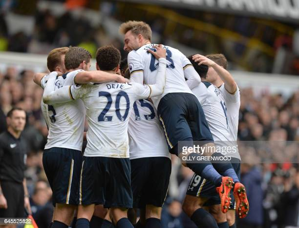 Tottenham players celebrates with Tottenham Hotspur's English striker Harry Kane after he scored his third goal to complete his hattrick during the...