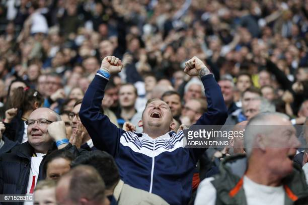 Tottenham Spur's fan celebrates after his team scores during the FA Cup semifinal football match between Tottenham Hotspur and Chelsea at Wembley...