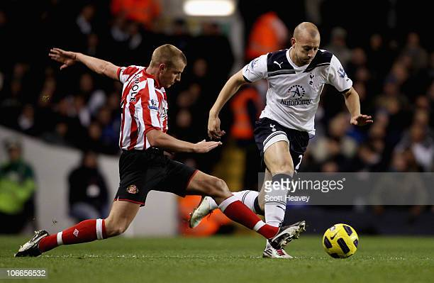 Tottenham's Alan Hutton in action with Sunderland'sLee Cattermole during the Premier League match between Tottenham Hotspur and Sunderland at White...