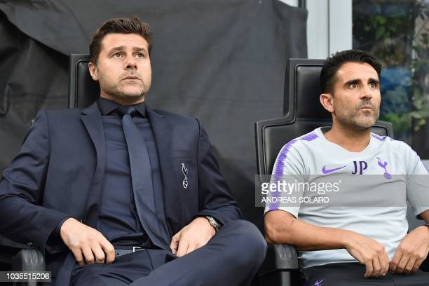 Tottenham's Argentine coach Mauricio Pochettino and assistant manager Jesus Perez attend the UEFA Champions League group stage football match Inter...
