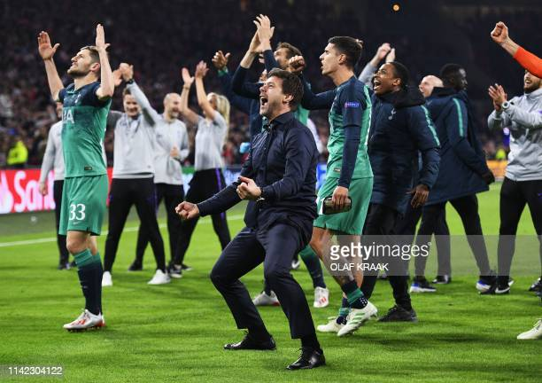 Tottenham's Argentine coach Mauricio Pochettino and players of Tottenham Hotspur celebrate after winning the UEFA Champions League semifinal second...