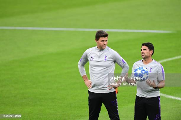 Tottenham's Argentine coach Mauricio Pochettino and Tottenham's assistant manager Jesus Perez attend a training session on the eve of the Champions...