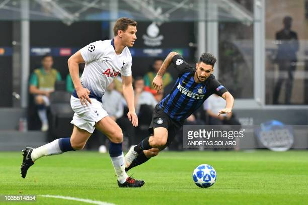 Tottenham's Belgian defender Jan Vertonghen outruns Inter Milan's Italian midfielder Matteo Politano during the UEFA Champions League group stage...