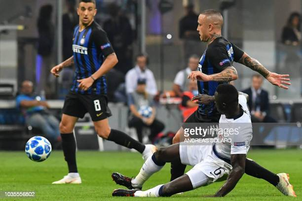 Tottenham's Colombian defender Davinson Sanchez tackles Inter Milan's Belgian midfielder Radja Nainggolan during the UEFA Champions League group...