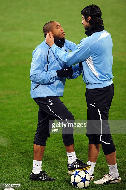 Tottenham's Croatian defender Vedran Corluka jokes with Tottenham's midfielder of Honduras Wilson Palacios during a training session on the eve of...