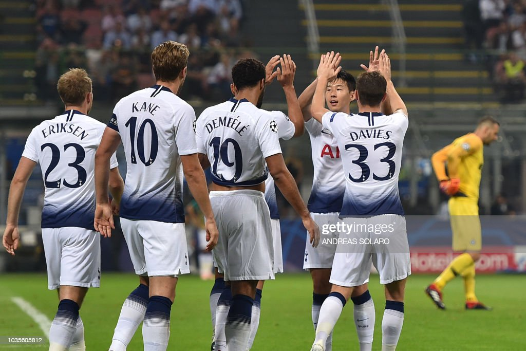 Tottenham's Danish midfielder Christian Eriksen, Tottenham's English forward Harry Kane, Tottenham's Belgian midfielder Moussa Dembele, Tottenham's South Korean forward Heung-min Son and Tottenham's Welsh defender Ben Davies celebrate after Tottenham's Danish midfielder Christian Eriksen opened the scoring during the UEFA Champions League group stage football match Inter Milan vs Tottenham on September 18, 2018 at the San Siro stadium in Milan.